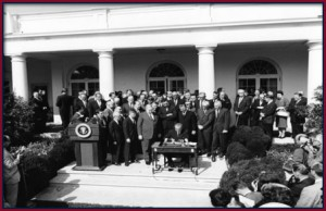 President Johnson signing the EOA, August 1964